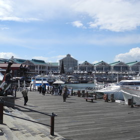 The Cape Town's waterfront is a hive of activity with numerous shops and restaurants.
