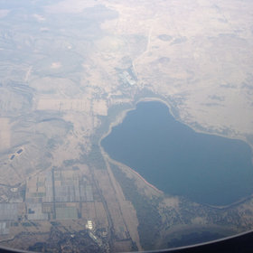Flying in from Europe, you descend over the Rift Valley (flamingo-fringed Lake Oloiden)…