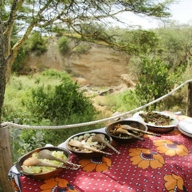 Meals are often eaten outdoors (Leieshwa Camp)…