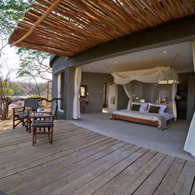 Mkulumadzi Lodge is a luxury retreat set at the confluence of two rivers in Majete Wildlife Reserve.