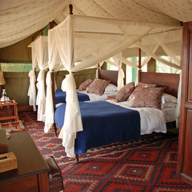 Two of the tents have twin (queen-sized) beds …