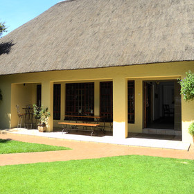 The Safari Club SA is made up of two thatched buildings set in nice gardens.