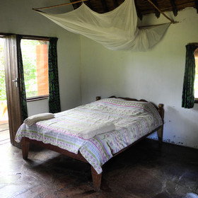 The rooms are quite simply furnished with a double bed and single bed downstairs