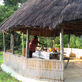 Breakfast and lunch are served in the covered dining area overlooking the river.