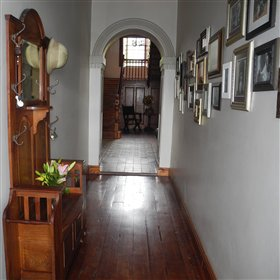 into the lovely restored house where you can still see the original wooden floors..