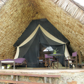 Under thatch and a banana leaf ceiling, the spacious rooms are kept cool.