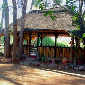Epupa Camp is built overlooking the Kunene River not far upstream from Epupa Falls.