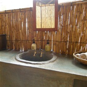 ... a wash-basin with hot and cold running water...