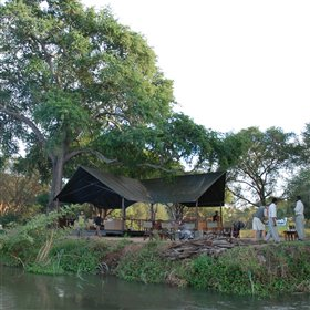 The central lounge and dining area at Old Mondoro is beside the river and very open...