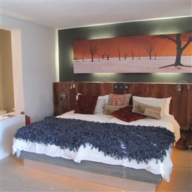 Complementing colours, linen and fittings theme each suite - Namib Junior Suite's warm desert tones