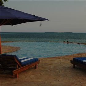 ...and afterwards relax on a sun-lounger beside the huge infinity pool.