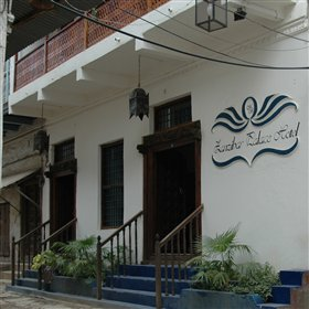 Zanzibar Palace Hotel is in a typical Stone Town street; distinguished by a sign and smart paint.