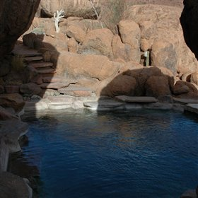 ..dining room and the pool, which is also set among the rocks.