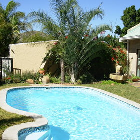 Nestled in amongst beautiful gardens is a refreshing pool.