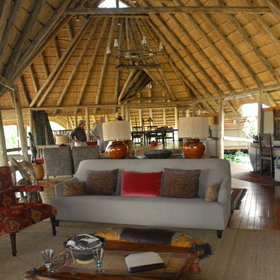 The main lodge is a beautiful thatched structure...