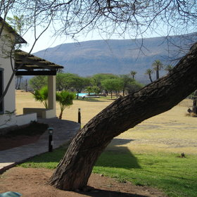 The Otavi Mountains provide a dramatic backdrop to the lodge