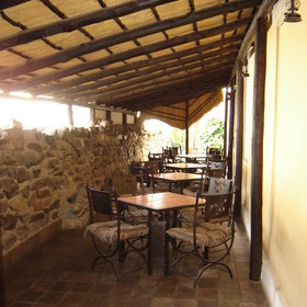 ...have your meal outside on the thatched veranda.