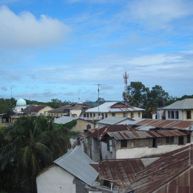 ...Across the multi-coloured iron roofs of Stone Town.