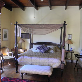 Most rooms have beautiful four-poster beds...