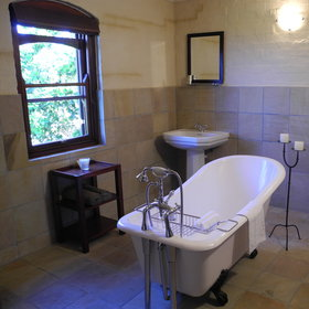 Each room has also its own stone tiled bathroom.