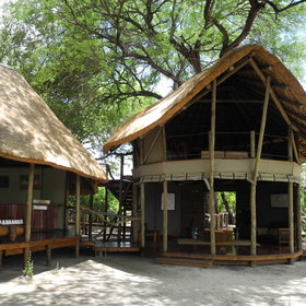 Tall riverine forest shades the central meeting point with upstairs lounge, and the dining room.