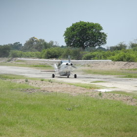 The camp is reached by light aircraft into Piajio Airstrip, about 5 to 10 minutes drive from camp.