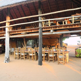 The thatched double story main area has the dining downstairs ....