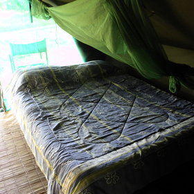 Inside the tents are simple with a bed covered in a mosquito net...