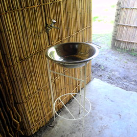 ... and a basin on a stand with a cold water tap. Hot water is brought to you every morning.