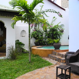 A small garden in the house acts like an oasis away from the streets of Stone Town.