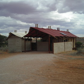 It stands on red Kalahari dunes overlooking a dry river bed.