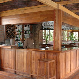There is also a bar area to enjoy drinks at served by charming staff…