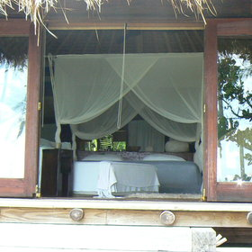 One side of each lodge faces the beach - with glass doors that open wide.