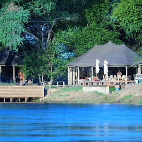 Ruckomechi Camp is situated along a long stretch of pristine Zambezi riverfront.
