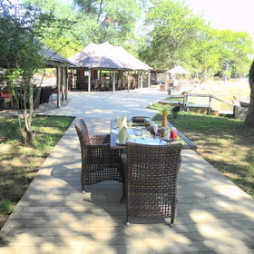 The main area contains an outdoor dining area...