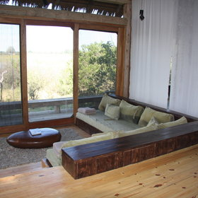 Each room has its own sunken lounge, overlooking a huge Okavango floodplain...