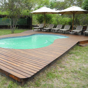Enjoy a swim in the plunge pool and relax on the surrounding deck chairs.
