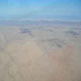 Fly over the inselbergs in Damaraland...