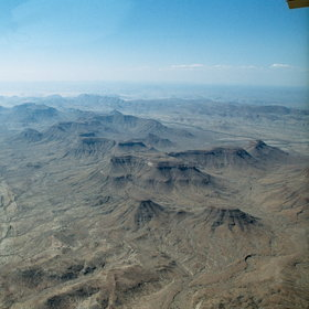 ...and admire the aerial views of Damaraland on the way back to Windhoek.