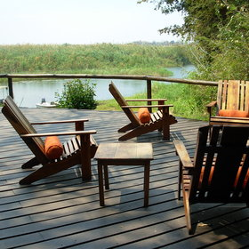 The main area is built on a raised deck overlooking the Zambezi River.