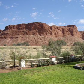Namib Desert Lodge stands 60km north of Sesriem, at the foot of red fossilised dunes.