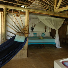 We love the rustic style of the cottages which are furnished using traditional kikoi material.