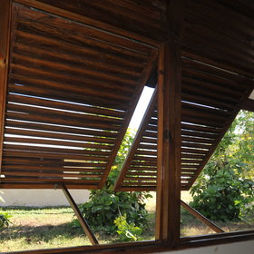 ...wide louver windows to allow a cooling breeze...