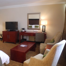 All rooms offer a TV as well as a small lounge area.