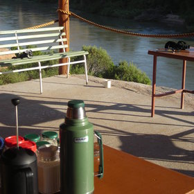 The dining area has a veranda with views of the Kunene River...