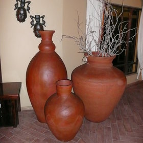 The decor is tasteful - with African prints, wooden masks and carvings, clay pots and earthy tones.