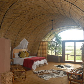 Insinde, all have twin beds with a mosquito net and a fan on the ceiling.