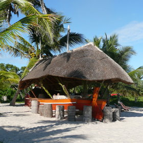 ... and has its own beach bar made from an old dhow!