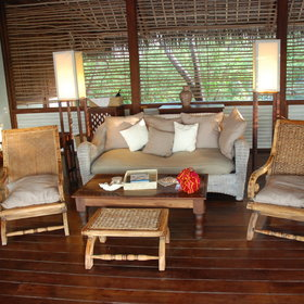 ...as well as an open-fronted, private sitting area with colonial-style furniture...