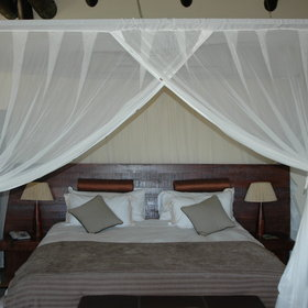 Each has a vast bed with stylish mosquito net...